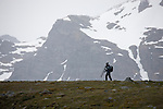 Photographer walking across ridge in St, Andrew's Bay, South Georgia Island