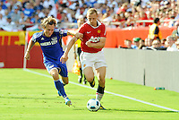 Ritchie De Laet (red), Michael Harington...Kansas City Wizards defeated Manchester United 2-1 in an international friendly at Arrowhead Stadium, Kansas City, Missouri.