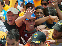 Venezuela: Caracas,10/06/12 .Opposition presidential candidate, Henrique Capriles, greets supporters during a walk of more than 10 km for several avenues in Caracas, where hundreds of thousands of Venezuelans, accompanied him to the National Electoral Council (CNE), which entered his candidacy for the upcoming presidential election on Oct. 7..Carlos Hernandez/Archivolatino