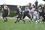 Vanderbilt running back Zac Stacy (2) eludes Ole Miss' Uriah Grant (98) in Nashville, Tenn. on Saturday, September 17, 2011. Vanderbilt won 30-7..