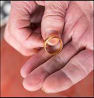 BNPS.co.uk (01202 558833)<br /> Pic: PhilYeomans/BNPS<br /> <br /> Lucky Irene finds her gold wedding ring...after 30 year wait.<br /> <br /> A widow has been reunited with her wedding ring 30 years after she lost it thanks to her metal-detecting son-in-law.<br /> <br /> Irene Freeman lost it outside her home in Basingstoke, Hants, in 1985 when she was playing with her nine-year-old daughter Kat.<br /> <br /> She didn't realise the 22ct gold band had come off until later in the day and, despite searching for it in the small front garden, Mrs Freeman could not find her beloved possession and gave up hope of ever seeing it again.<br /> <br /> But she never forgot about it and jokingly mentioned to her daughter Kat's partner Malcolm Williams he could try finding it when they talked about his metal detecting hobby.