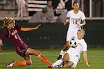 07 November 2008: Virginia Tech's Brittany Michaels (left) and Virginia's Sarah Senty (right) challenge for the ball. The University of Virginia and Virginia Tech played to a 1-1 tie after 2 overtimes at WakeMed Stadium at WakeMed Soccer Park in Cary, NC in a women's ACC tournament semifinal game.  Virginia Tech advanced to the final on penalty kicks, 2-1.