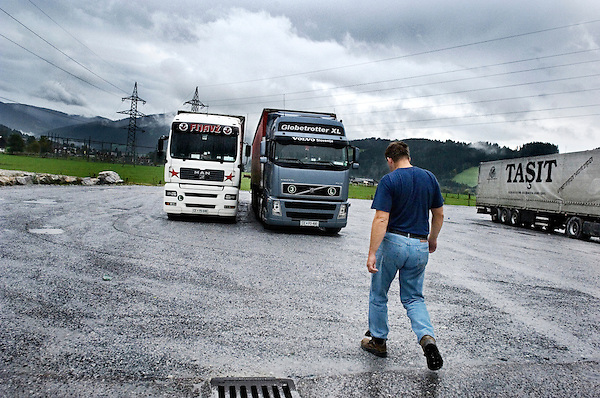 Istok Jeza is a truckdriver. He lives in Slovenia in a town called Pagersko together with his wife Vlaska and their two sons, Benjamin and Vojklo. This is his home for two nights each week. .The rest of the time is he spending in his white MAN-truck, along the European highways, carrying goods from East to West..The cabin is his bedroom, living room and workplace. He connect with his friends through the crunchy two ways radio. Sometimes they meet on the trailer parks to eat breakfast or dinner together..In Pagersko, the youngest child, Benjamin, dreams of living the life his father Istok has. .Love is central in the Jeza family. If it's despite, or thanks to, the trucker life, has to be unsaid. ..To be a truckdriver in Europe you need to enjoy your own company. For many days in a row, you are on the road by yourself and the only connection with friends and family are on the telephone or on a two ways radio. .You are travelling from East to West Europe, passing long distances at the highways with tons of different cargos every day. Some truckdrivers live on the road, having their entire life inside the truckcabin. But there are also those, which have a family waiting for them, somewhere in Europe, longing and wanting them to come home at the end of the week..The Tachograf regulate the working hours, so that the drivers aren&acute;t a danger for them self or to other fellow road-users. It can easily become a lot of driving hours since the drivers doesn&acute;t get payed when the truck are parked. In some of the countries, your aren&acute;t allowed to drive a truck during the weekend. Because of that, many of the drivers get stranded, and won&acute;t be able to come home to their families and home countries...This picture: Istok Jeza in his MAN truck in the morning somewhere in Austria.