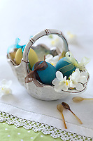A pretty ceramic basket filled with coloured eggs tied with ribbon makes a lovely Easter decoration