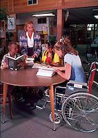 Librarian assisting teens