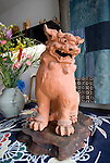 A shisa statue used to ward off evil stands at the entrance to  traditional sweet maker Janaha Kippan in Naha, Okinawa, Japan on 27 June 2012. Today the Jahana family are the only people still making the traditional Kippan and Tougatsuke sweets that were served at the court of the Ryukyu kings over 300 years ago. Photo: Robert Gilhooly.