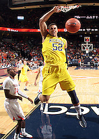 CHARLOTTESVILLE, VA- NOVEMBER 29: Jordan Morgan #52 of the Michigan Wolverines dunks the ball over K.T. Harrell #24 of the Virginia Cavaliers during the game on November 29, 2011 at the John Paul Jones Arena in Charlottesville, Virginia. Virginia defeated Michigan 70-58. (Photo by Andrew Shurtleff/Getty Images) *** Local Caption *** Jordan Morgan;K.T. Harrell