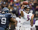 Baltimore Ravens quarterback Joe Flacco passes against the Seattle Seahawks  at CenturyLink Field in Seattle, Washington on November 13, 2011. The Seahawks beat the Ravens 22-17.  ©2011 Jim Bryant Photo. All Rights Reserved.