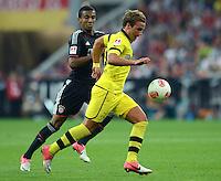 FUSSBALL   1. BUNDESLIGA   SAISON 2012/2013   SUPERCUP FC Bayern Muenchen - Borussia Dortmund            12.08.2012 Luiz Gustavo (li, FC Bayern Muenchen)  gegen Mario Goetze (Borussia Dortmund)