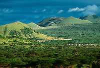 The hillsides of Hawaii against the sea.