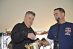 Fund raiser for firefighter Ray Pfeifer on Saturday, March 31, 2012, at East Meadow Firefighters Benevolent Hall, New York, USA. At left, Congressman Pete King (Republican - NY) helped pick raffle winners.