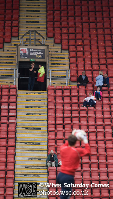 Fans of Crewe Alexandra sitting on the main stand watching the players warming up prior to their League 2 fixture against Aldershot Town at the Alexandra Stadium. The visitors won by 2 goals to 1.