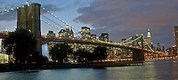 Brooklyn Bridge; New York City, NY, designed by John Augustus Roebling, waterfall designed created by Olafur Eliasson, Manhattan, Dusk