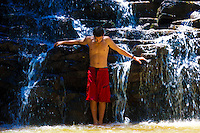 A teenager enjoying the waterfall at Twin Falls, Haiku, Maui