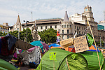 Protest camp at Placa de Catalunya, Barcelona, Spain. The signs read: &quot;Animals and music will make you a better person; put a dog and a flute in your life&quot;. The square has been relatively quiet since police attacked and beat protestors on May 27 2011.