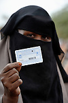 A woman in the Dadaab refugee camp in northeastern Kenya displays her United Nations-issued ration card. Tens of thousands of refugees have fled drought-stricken Somalia in recent weeks, swelling what was already the world's largest refugee settlement.