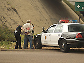 Transient man being arrested by police near an overpass