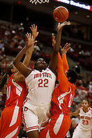 Ohio State Buckeyes center Darryce Moore (22) drives against Bowling Green Falcons forward Jill Stein (40) and Bowling Green Falcons guard Erica Donovan (21) in the first half at Value City Arena in Columbus Nov. 24, 2013.