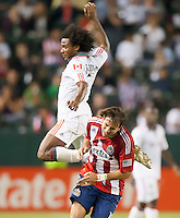 CARSON, CA – OCTOBER 9: Toronto FC midfielder Julian De Guzman (6) and Chivas USA forward Alan Gordon (16) during a soccer match at Home Depot Center, October 9, 2010 in Carson California. Final score Chivas USA 3, Toronto FC 0...