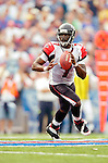 25 September 2005: Michael Vick (7), Quarterback for the Atlanta Falcons, scrambles untouched in the backfield during a game against the Buffalo Bills. The Falcons defeated the Bills 24-16 at Ralph Wilson Stadium in Orchard Park, NY.<br /><br />Mandatory Photo Credit: Ed Wolfstein.