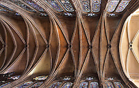 Rib vaulted ceiling of the 7-bayed nave and 2-bayed narthex, with stone bosses and stained glass windows, Chartres Cathedral, Eure-et-Loir, France. Chartres cathedral was built 1194-1250 and is a fine example of Gothic architecture. It was declared a UNESCO World Heritage Site in 1979. Picture by Manuel Cohen