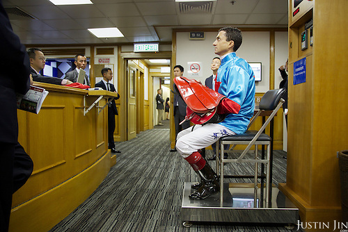 A jockey being weighed before the race the Hong Kong Jockey Club's Happy Valley Racecourse.