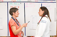 Alicia Jacobs, M.D., left, works with Amanda Dauten, class of 2015, at Colchester Family Practice.