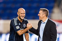 Sporting Kansas City Aurelien Collin (78) celebrates with manager Peter Vermes after defeating the New York Red Bulls. Sporting Kansas City defeated the New York Red Bulls 1-0 during a Major League Soccer (MLS) match at Red Bull Arena in Harrison, NJ, on April 17, 2013.