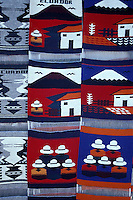 Woven wall hangings for sale at the Handicrafts market in Poncho Plaza, Otavalo, Ecuador