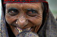 Portrait of a Bakarwal woman.<br />