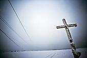 Niegowa 01.2010 Poland<br /> Frozen Cross on the Road.<br /> Three atmospheric forces: rain, snow and frost have changed into an ecological disaster the Myszkowski district in the Czestochowskie province,.located 230 kilometers south of Warsaw. Almost 95% of all trees are down.Thousands of homes are left without electricity.<br /> Photo: Adam Lach / Napo Images for Newsweek Polska<br /> <br /> Zamarzniety krzyz na drodze w pow.myszkowskim.<br /> Wstepnie &quot;tylko&quot; 95% scietych drzew w dwoch powiatach. 0.5 miliona metrow szesciennych zniszczonych lasow..Tysiace gospodarstw bez pradu. Wszyscy maja swiadomosc, ze na kumulacje trzech niekorzystnych .zjawisk atmosferycznych rady nie ma..Trzy zjawiska kt&oacute;re zamienily jeden z obszarow Polski w istna katastrofe ekologiczna: deszcz, snieg i szadz.<br /> Fot: Adam Lach / Napo Images dla Newsweek Polska