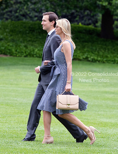Jared Kushner and Ivanka Trump walk on the South Lawn of the White House to join United States President Donald J. Trump aboard Marine One as they depart the White House in Washington, DC  for a trip to New York City on Thursday, May 4, 2017.<br /> Credit: Ron Sachs / CNP