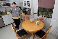 NWA Democrat-Gazette/DAVID GOTTSCHALK  Mary Irwin-Mann stands in her favorite personal space, around the kitchen table at her home in Fayetteville.