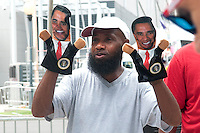 """CHARLOTTE, NC - September 5, 2012: John Smith hawks puppets outside the Charlotte Convention Center. """"What politician is not a puppet,"""" he said when asked if he thought Obama was a puppet, """"Do you think the president actually runs anything?"""""""