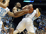 20 January 2016: Wake Forest's Devin Thomas (left) grabs the ball off of the back of North Carolina's Marcus Paige (right). The University of North Carolina Tar Heels hosted the Wake Forest University Demon Deacons at the Dean E. Smith Center in Chapel Hill, North Carolina in a 2015-16 NCAA Division I Men's Basketball game. UNC won the game 83-68.