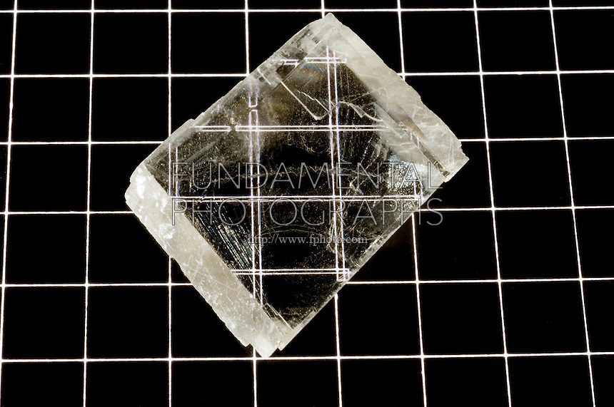 CALCITE - DOUBLE REFRACTION<br /> Calcium Carbonate (CaCO3)<br /> (Variations Available)<br /> Double refraction occurs when a ray of light enters the crystal it is split into fast and slow beams. As these two beams exit the crystal they are bent into two different angles because the angle is affected by the speed of the beams.