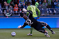 Steve Zakuani (11) of the Seattle Sounders works the ball around Chivas USA goalkeeper Zach Thornton (22) at the XBox 360 Pitch at Quest Field in Seattle, WA on October 15, 2010. The Sounders defeated Chivas USA 2-1.