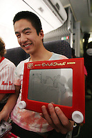 3 April 2008: A member of the Stanford Band draws an Etch A Sketch artwork of Cissy Pierce during Stanford's travel day to the 2008 NCAA Division I Women's Basketball Final Four in Tampa Bay, FL.