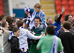 St Johnstone v Morton....02.05.09.Alan Main with his son Christopher on his shoulders is mobbed by the saints fans as they invade the pitch at full time.Picture by Graeme Hart..Copyright Perthshire Picture Agency.Tel: 01738 623350  Mobile: 07990 594431