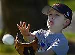 Young baseball player, Jonathan Hicks, 6, learns to catch the ball during practice at Ellen Feickert Elementary School in Elk Grove, Saturday March 13, 2004. With the growth of the Elk Grove comes other demands like the large number of children signing up to play in a baseball league..Sacramento Bee/  Brian Baer