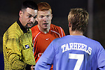 11 November 2005: Referee Shane Moody (left) pulls North Carolina's Scott Campbell (right) and Clemson's Alan O'Hara (center) aside for a few stern words of caution. The University of North Carolina defeated Clemson University 2-0 at SAS Stadium in Cary, North Carolina in a semifinal of the 2005 ACC Men's Soccer Championship.