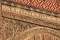 Architectural detail of the Puerta de San Ildefonso, built under Al-Hakam II in the 10th century, one of the West facade entrances to the Cathedral-Great Mosque of Cordoba, on the Calle Torrijos in Cordoba, Andalusia, Southern Spain. This detail shows the frame around the arched doorway, with kufic inscription and intricately carved vegetal patterns. The first church built here by the Visigoths in the 7th century was split in half by the Moors, becoming half church, half mosque. In 784, the Great Mosque of Cordoba was begun in its place and developed over 200 years, but in 1236 it was converted into a catholic church, with a Renaissance cathedral nave built in the 16th century. The historic centre of Cordoba is listed as a UNESCO World Heritage Site. Picture by Manuel Cohen
