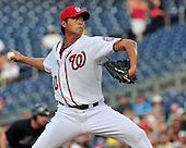 Washington Nationals pitcher Chien-Ming Wang (40) pitches in the first inning against the New York Mets at Nationals Park in Washington, D.C. on Friday, July 29, 2011.  Wang is a former New York Yankee pitcher who was injured exactly 2 years ago..Credit: Ron Sachs / CNP.(RESTRICTION: NO New York or New Jersey Newspapers or newspapers within a 75 mile radius of New York City)