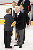 "Don ""Toot"" Cahoon (UMass - Head Coach) shakes hands with Jerry York (BC - Head Coach), Mike Cavanaugh (BC - Associate Head Coach) and Greg Brown (BC - Assistant Coach). - The Boston College Eagles defeated the visiting University of Massachusetts-Amherst Minutemen on Friday, October 21, 2011, at Kelley Rink at Conte Forum in Chestnut Hill, Massachusetts."