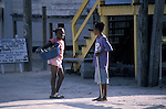 Young black children chatting on Caye Caulker, Belize