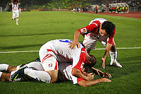 The Costa Rican team piles on top of Marcos Urena (7) after he made a second goal against Egypt during the FIFA Under 20 World Cup Round of 16 match between Egypt and Costa Rica at the Cairo International Stadium on October 06, 2009 in Cairo, Egypt.