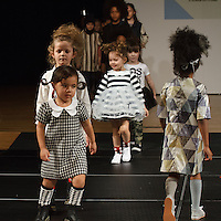 Models walk runway at the close of the petitePARADE Children's Club fashion show at the Jacob Javits Center in New York City, on January 9, 2016.