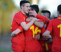 Stebonheath Park,Llanelli, Dyfed,Wales. Wednesday 6th Feb 2013. Wales v Iceland U21 International football friendly. Wes Burns of Wales and Bristol City is congratulated by his team mates on scoring his sides 1st goal during the Wales v Iceland U21 International football friendly match. Mandatory credit Jeff Thomas Photography-07837 386244-www.jaypics.co.uk