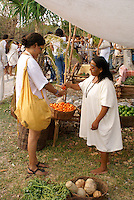 Tourist buying fruit at the recreation of an ancient Mayan market, Sacred Mayan Journey 2011 event, Riviera Maya, Quintana Roo, Mexico
