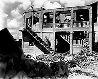 A Marine from the Third Marine Division goes after a sniper in a shelled building, Guam, August 1944.  Cpl. J. F. Andrejka (Marine Corps)<br /> Exact Date Shot Unknown<br /> NARA FILE #:  127-N-151749<br /> WAR &amp; CONFLICT BOOK #:  1190